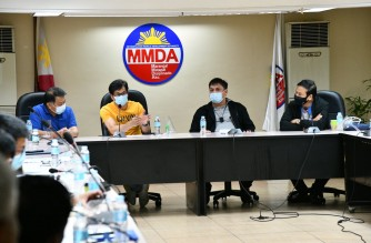 Metropolitan Manila Development Authority Chair Benhur Abalos speaks to DPWH and DOTr representatives, and others in a meeting at the MMDA headquarters on Wednesday, Jan. 21./MMDA/