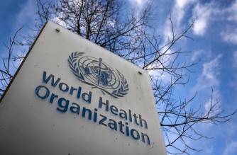 This photograph taken on January 29, 2021 shows a sign of the World Health Organization (WHO) at the entrance of their headquarters in Geneva amid the Covid-19 outbreak, caused by the novel coronavirus. (Photo by Fabrice COFFRINI / AFP)