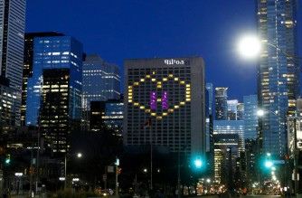 (FILES) In this file photo taken on April 19, 2020, a heart is lit on a Hilton Hotel in downtown Toronto in support of healthcare workers. - Travelers coming to Canada will have to quarantine in hotels for at least three days under strict supervision and at their own expense, Prime Minister Justin Trudeau announced on January 29, 2021, citing concerns over new coronavirus strains. (Photo by Cole BURSTON / AFP)