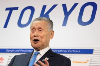 """(FILES) This file photo taken on October 17, 2019 shows Tokyo 2020 president Yoshiro Mori speaking to the media in Tokyo on plans to move the marathon and race walks from the Japanese capital to Sapporo. - Tokyo 2020 Games chief Yoshiro Mori has apologised and said he may have to resign after sparking a sexism row by claiming women """"have difficulty"""" speaking concisely, a Japanese daily said on February 4, 2021. (Photo by Kazuhiro NOGI / AFP)"""