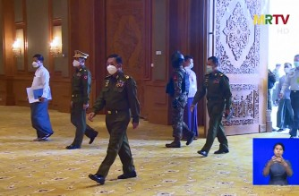 "This screengrab provided via AFPTV and taken from a broadcast by Myanmar Radio and Television (MRTV) in Myanmar on February 3, 2021 shows military chief General Min Aung Hlaing (3rd L) arriving for a meeting at the Union of Myanmar Federation of Chambers of Commerce and Industry in Naypyidaw following February 1  military coup. (Photo by - / Myanmar Radio and Television / AFP) / -----EDITORS NOTE --- RESTRICTED TO EDITORIAL USE - MANDATORY CREDIT ""AFP PHOTO / Myanmar Radio and Television via AFPTV"" - NO MARKETING - NO ADVERTISING CAMPAIGNS - DISTRIBUTED AS A SERVICE TO CLIENTS"