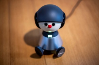 In this picture taken on February 4, 2021 shows communication robot Charlie being pictured in Nami Hamaura's apartment in Tokyo. - Smart home assistants like Amazon's Alexa have found success worldwide, but tech firms in Japan are reporting huge demand for more humanlike alternatives, as people seek solace during virus isolation. (Photo by Philip FONG / AFP) / TO GO WITH: Japan-lifestyle-tech-robots-health-virus, FOCUS by Harumi OZAWA