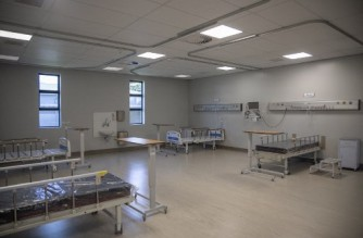A newly constructed ward is seen at the Jubilee District Hospital in Hammanskraal, on February 8, 2021. The extension of the Jubilee Hospital is South AfricaÕs first hospital built with a light steel frame. Constructed by Futurecon and Concor and handed over at the end of November 2020, the new extension provides 5 ICU and 5 high care units totalling 300 beds to meet governmentsÕ needs of hospital worsened by the COVID-19 coronavirus pandemic. (Photo by Michele Spatari / AFP)