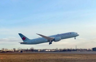 (FILES) In this file photo an Air Canada Boeing 787-9 Dreamliner takes off from Montreal's  Pierre Elliott Trudeau International Airport, on December 11, 2019. - Air Canada announced on February 9, 2021 the suspension of 17 US and international routes until the end of April and layoffs of 1,500 workers, citing a drop in demand for travel after a tightening of public health restrictions to slow the spread of new Covid-19 variants. (Photo by Daniel SLIM / AFP)