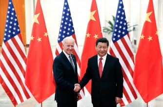 (FILES) In this file photo taken on December 04, 2013 Chinese President Xi Jinping (R) shakes hands with US Vice President Joe Biden (L) inside the Great Hall of the People in Beijing. - US President Joe Biden expressed concerns to Chinese leader Xi Jinping about human rights in Hong Kong and Xinjiang late February 10, 2021, in their first call since Biden took office on January 20, according to the White House. (Photo by LINTAO ZHANG / POOL / AFP)