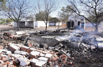 In this picture taken on February 12, 2021 smoke billows from the remains of a firecracker factory near Sattur in Virudhunagar district of Tamil Nadu state, following an explosion on February 12 that killed at least 19 people and hurt dozens. (Photo by - / AFP)