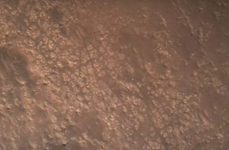 "This NASA video frame grab photo released on February 22, 2021 shows the surface of Mars, NASA's Mars 2020 Perseverance mission captured in footage of its rover landing in Mars' Jezero Crater on February 18, 2021, the real footage in this video was captured by several cameras that are part of the rover's entry, descent, and landing suite, the views include a camera looking down from the spacecraft's descent stage (a kind of rocket-powered jet pack that helps fly the rover to its landing site), a camera on the rover looking up at the descent stage, a camera on the top of the aeroshell (a capsule protecting the rover) looking up at that parachute, and a camera on the bottom of the rover looking down at the Martian surface. - The US space agency NASA on February 22, 2021 released the first video of the landing of the Perseverance rover on Mars. The video clip, lasting three minutes and 25 seconds, showed the deployment of the parachute and the rover's touchdown on the surface of the Red Planet. ""These are really amazing videos,"" said Michael Watkins, director of NASA's Jet Propulsion Laboratory. ""This is the first time we've ever been able to capture an event like the landing on Mars."" (Photo by Handout / NASA / AFP) / RESTRICTED TO EDITORIAL USE - MANDATORY CREDIT ""AFP PHOTO /NASA/JPL-Caltech/HANDOUT "" - NO MARKETING - NO ADVERTISING CAMPAIGNS - DISTRIBUTED AS A SERVICE TO CLIENTS"