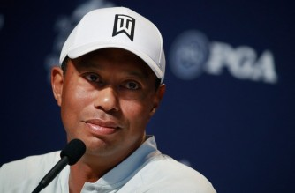 "(FILES) In this file photo Tiger Woods of the United States speaks to the media during a press conference prior to the 2018 PGA Championship at Bellerive Country Club on August 7, 2018 in St. Louis, Missouri. - Tiger Woods is not facing charges of reckless driving following the car crash in which he suffered serious leg injuries, authorities said on February 24, 2021. ""A reckless driving charge has a lot of elements into it, this is purely an accident,"" Los Angeles County Sheriff Alex Villanueva told reporters. (Photo by ANDY LYONS / GETTY IMAGES NORTH AMERICA / AFP)"