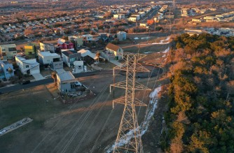 AUSTIN, TEXAS - FEBRUARY 19: An aerial view from a drone shows electrical lines running through a neighborhood on February 19, 2021 in Austin, Texas. Amid days of nationwide frigid winter storms in which 58 people died, more than 4 million Texans were without power for much of the past week, with about 13 million Texans being forced to boil tap water in the aftermath of the strain on infrastructure.   Joe Raedle/Getty Images/AFP (Photo by JOE RAEDLE / GETTY IMAGES NORTH AMERICA / AFP)