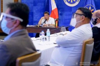 President Rodrigo Roa Duterte presides over a meeting with the Inter-Agency Task Force on the Emerging Infectious Diseases (IATF-EID) core members prior to his talk to the people at the Arcadia Active Lifestyle Center in Matina, Davao City on February 15, 2021. JOEY DALUMPINES/ PRESIDENTIAL PHOTO