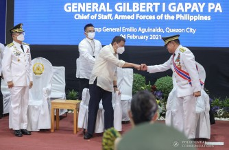 President Rodrigo Roa Duterte fist bumps with outgoing Armed Forces of the Philippines (AFP) Chief of Staff General Gilbert Gapay during the AFP Change of Command and Retirement Ceremony at Camp Emilio Aguinaldo in Quezon City on  February 4, 2021. ROBINSON NIÑAL/ PRESIDENTIAL PHOTO