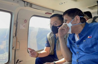 "President Rodrigo Duterte and Senator Christopher ""Bong"" Go during an aerial inspection of areas hit by severe floods and affected by the previous storm ""Auring.""  President Duterte and his former aide, Senator Go, made the aerial inspection on Tuesday, Feb. 23, 2021 after the storm which later weakened into a low pressure area, had already dissipated.  (Photo courtesy Sen. Bong Go)"