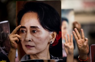 A protester holds a photo of detained Myanmar civilian leader Aung San Suu Kyi during a demonstration against the military coup outside the Myanmar Embassy in Bangkok on February 7, 2021. (Photo by Jack TAYLOR / AFP)