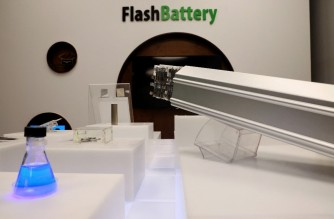 A display promoting fast-charging batteries at the entrance of the Israeli startup StoreDot's headquarters is pictured in the Israeli coastal city of Herziliya on February 16, 2021. - Israeli ultra-fast charge specialists StoreDot have developed a first generation lithium-ion battery that can rival the filling time of a standard car at the pump. (Photo by Emmanuel DUNAND / AFP)