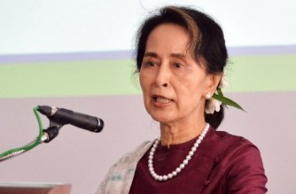 (FILES) In this file photo taken on July 17, 2019, Myanmar's State Counsellor Aung San Suu Kyi speaks during the opening ceremony of the Yangon Innovation Centre in Yangon. - Ousted Myanmar civilian leader Aung San Suu Kyi was hit with two new criminal charges when she appeared in court via video link on March 1, 2021, a month after a military coup triggered relentless and massive protests. (Photo by STR / AFP)