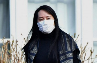 Huawei Chief Financial Officer, Meng Wanzhou, leaves her Vancouver home to attend British Columbia Supreme Court, in Vancouver, British Columbia on March 1, 2021. (Photo by Don MacKinnon / AFP)