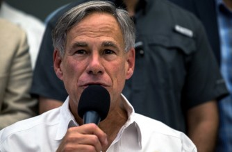 "(FILES) In this file photo taken on August 03, 2019 Texas Governor Greg Abbott speaks during a press briefing, following a mass fatal shooting, at the El Paso Regional Communications Center in El Paso, Texas. - Texas Governor Greg Abbott lifted a state mask mandate on March 2, 2021, and said he was authorizing businesses restricted because of the coronavirus pandemic to open ""100 percent."" (Photo by Joel Angel JUAREZ / AFP)"