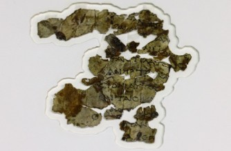 Recently-discovered 2000-year-old biblical scroll fragments from the Bar Kochba period, are displayed at the Israel Antiquities Authority's (IAA) Dead Sea conservation lab in Jerusalem, on March 16, 2021, after completion of preservation work. - Israel described the find, which includes a cache of rare coins, a six-millennia-old skeleton of a child and basket it described as the oldest in the world, at over 10,000 years, as one of the most significant since the Dead Sea Scrolls. The fragments, found following a survey in a desert area spanning southern Israel and the occupied West Bank, include passages in Greek from the Book of the Twelve Minor Prophets including the books of Zechariah and Nahum, the IAA said. (Photo by MENAHEM KAHANA / AFP)