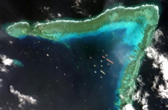 "This handout satellite imagery taken on March 23, 2021 and received on March 25 from Maxar Technologies shows Chinese vessels anchored at the Whitsun Reef, around 320 kilometres (175 nautical miles) west of Bataraza in Palawan in the South China Sea. - Chinese vessels gathered near a disputed reef in the South China Sea are ""fishing boats"" sheltering from poor weather, the foreign ministry said March 22, a day after the Philippines described their presence as an incursion. (Photo by Handout / Satellite image ©2021 Maxar Technologies / AFP) / THE WATERMARK MAY NOT BE REMOVED/CROPPED -----EDITORS NOTE --- RESTRICTED TO EDITORIAL USE - MANDATORY CREDIT ""AFP PHOTO / Satellite image ©2021 Maxar Technologies"" - NO MARKETING - NO ADVERTISING CAMPAIGNS - DISTRIBUTED AS A SERVICE TO CLIENTS"