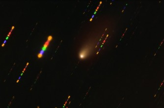 """This handout image made available on March 30, 2021 by the European Southern Observatory shows the comet 2I/Borisov passing near the Sun taken with the FORS2 instrument on ESO's Very Large Telescope in late 2019. - Since the comet was travelling at breakneck speed, around 175 000 kilometres per hour, the background stars appeared as streaks of light as the telescope followed the comet's trajectory. The colours in these streaks give the image some disco flair and are the result of combining observations in different wavelength bands, highlighted by the various colours in this composite image. (Photo by O. HAINAUT / EUROPEAN SOUTHERN OBSERVATORY / AFP) / RESTRICTED TO EDITORIAL USE - MANDATORY CREDIT """"AFP PHOTO EUROPEAN SOUTHERN OBSERVATORY / O.HAINAUT"""" - NO MARKETING - NO ADVERTISING CAMPAIGNS - DISTRIBUTED AS A SERVICE TO CLIENTS"""
