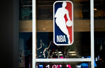 NEW YORK, NY - MARCH 12: An NBA logo is shown at the 5th Avenue NBA store on March 12, 2020 in New York City. The National Basketball Association said they would suspend all games after player Rudy Gobert of the Utah Jazz reportedly tested positive for the Coronavirus (COVID-19).   Jeenah Moon/Getty Images/AFP (Photo by Jeenah Moon / GETTY IMAGES NORTH AMERICA / Getty Images via AFP)