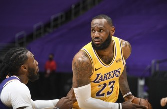 LOS ANGELES, CA - MARCH 2: LeBron James #23 of the Los Angeles Lakers handles the ball during the game against the Phoenix Suns on March 2, 2021 at STAPLES Center in Los Angeles, California. NOTE TO USER: User expressly acknowledges and agrees that, by downloading and/or using this Photograph, user is consenting to the terms and conditions of the Getty Images License Agreement. Mandatory Copyright Notice: Copyright 2021 NBAE   Andrew D. Bernstein/NBAE via Getty Images/AFP (Photo by ANDREW D. BERNSTEIN / NBAE / Getty Images / Getty Images via AFP)