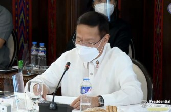 Health Secretary Francisco Duque III explaining to President Rodrigo Duterte the situation of the various regions in the country experiencing a spike in COVID-19 cases, as well as the updates on the vaccine rollout,  on Monday, March 15, 2021 (Screenshot of PCOO video/Courtesy PCOO)
