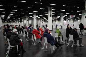 Elderly people wait at the coronavirus (Covid-19) vaccination center for their vaccination in Cologne, western Germany, on February 8, 2021. (Photo by Ina FASSBENDER / AFP)