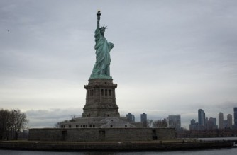 General View of Statue of Liberty in New York City on March 01, 2021. - A year after the beginning of the pandemic, tourists, especially foreigners, have yet to return to New York; in the meantime, many New Yorkers are taking the opportunity to discover, or rediscover, the city's emblematic places, which they have been avoiding until now. (Photo by Kena Betancur / AFP)
