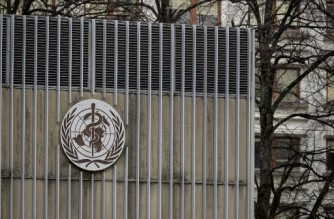 This photograph taken on March 5, 2021 shows the sign of the World Health Organization (WHO) at their headquarters in Geneva amid the Covid-19 coronavirus outbreak. (Photo by Fabrice COFFRINI / AFP)