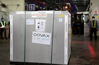 A container carrying first shipment of the AstraZeneca/Oxford Covid-19 coronavirus vaccine doses, as part of the UN global Covax programme, arrives at the Noi Bai International Airport Cargo terminal in Hanoi on April 1, 2021. (Photo by Nhac NGUYEN / AFP)