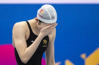 Japanese swimmer Rikako Ikee reacts after winning the 100m butterfly final during the Japan National Swimming Championships, which doubles as a qualifying event for the coronavirus-delayed 2020 Tokyo Olympics, at the Tokyo Aquatics Centre on April 4, 2021. (Photo by CHARLY TRIBALLEAU / AFP)