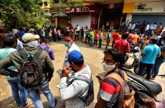 People queue outside the Chemists Association office for Remdesivir, an antiviral drug, in Pune on April 9, 2021 as India surged past 13 million coronavirus cases. (Photo by - / AFP)