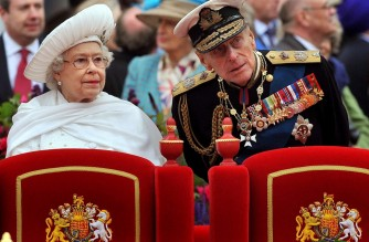 (FILES) In a file picture taken on June 3, 2012 shows Britain's Queen Elizabeth II (L) and Prince Philip, Duke of Edinburgh (R), standing onboard the Spirit of Chartwell during the Thames Diamond Jubilee Pageant on the River Thames in London. - Queen Elizabeth II's 99-year-old husband Prince Philip, who was recently hospitalised and underwent a successful heart procedure, died on April 9, 2021, Buckingham Palace announced. (Photo by John Stillwell / POOL / AFP)