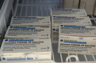 (FILES) In this file photo taken on March 4, 2021 Johnson & Johnson Covid-19 Janssen Vaccine boxes sit in a locked refrigerator at the US Department of Veterans Affairs' VA Boston Healthcare System's Jamaica Plain Medical Center in Boston, Massachusetts. - European regulators in April 2021 are reviewing side effects of Johnson & Johnson's single-dose Covid-19 shot, after a handful of cases of rare blood clots were reported among its recipients. Overall, the vaccine prevented moderate to severe Covid-19 by 66.1 percent 28 days after the shot, but this rose to 85.4 percent when considering only severe disease. (Photo by Joseph Prezioso / AFP)