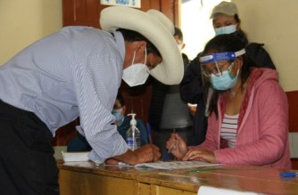 "In this picture released by Peruvian news agency Andina, Peruvian presidential candidate for the Peru Libre (Free Peru) Party, Pedro Castillo, signs a voters log after casting his vote at a polling station in Cajamarca, Peru, during general elections on April 11, 2021. - An early exit poll by the IPSOS firm, released soon after voting stations closed, gave the radical left unionist Pedro Castillo the first place, with 16.1%. Some 25 million Peruvians voted today for a new president and 130 members of the unicameral congress amid the country's deadliest week of the coronavirus pandemic and a surge in new infections. A runoff second vote is scheduled on June 6. (Photo by - / ANDINA / AFP) / RESTRICTED TO EDITORIAL USE - MANDATORY CREDIT ""AFP PHOTO / ANDINA "" - NO MARKETING - NO ADVERTISING CAMPAIGNS - DISTRIBUTED AS A SERVICE TO CLIENTS"