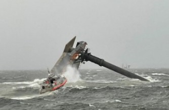 """This US Coast Guard handout photo shows Coast Guard Station Grand Isle 45-foot Respone Boat-Medium boatcrew heading toward a capsized 175-foot commerical lift boat April 13, 2021 searching for people in the water 8 miles south of Grand Isle, Louisiana. - One person died and 12 were missing after a commercial lift vessel capsized in the Gulf of Mexico off the coast of Louisiana, the US Coast Guard said April 14. Coast Guard ships and a fleet of volunteer vessels were deployed to search for survivors after the Seacor Power capsized Tuesday in an unexpectedly strong storm near Port Fourchon, about 160 kilometers (100 miles) south of New Orleans. (Photo by - / US COAST GUARD / AFP) / RESTRICTED TO EDITORIAL USE - MANDATORY CREDIT """"AFP PHOTO /  US COAST GUARD / HANDOUT"""" - NO MARKETING - NO ADVERTISING CAMPAIGNS - DISTRIBUTED AS A SERVICE TO CLIENTS"""