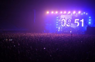 (FILES) In this file photo taken on March 27, 2021 spectators attend a rock music concert by Spanish group Love of Lesbian at the Palau Sant Jordi in Barcelona. - Six people out of 5,000 who attended an indoor trial concert last month in Barcelona reported testing positive for Covid-19 afterwards, organisers said on April 27, 2021, giving hope for the revival of the live music industry. Ahead of the indie rockers Love of Lesbian's show, everyone underwent mass screening and antigen tests. (Photo by LLUIS GENE / AFP)