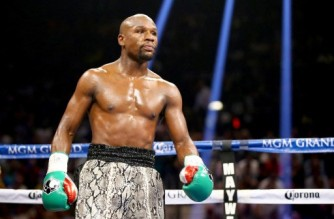 "(FILES) In this file photo taken on September 13, 2014 Floyd Mayweather Jr. looks on while taking on Marcos Maidana during their WBC/WBA welterweight title fight at the MGM Grand Garden Arena in Las Vegas, Nevada. - Former world welterweight king Floyd Mayweather said April 27 he will face off against YouTube personality Logan Paul in an exhibition bout at Miami's Hard Rock Stadium on June 6. ""Logan Paul and I are going to fight at Hard Rock Stadium. Mayweather Promotions, Fanmio and Showtime will team up to give you an epic event,"" Mayweather wrote on Instagram. (Photo by AL BELLO / GETTY IMAGES NORTH AMERICA / AFP)"