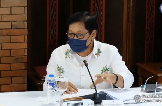 """(File photo) Labor Secretary Silvestre Bello III explaining his concern on what he thinks is a long quarantine period for returning OFWs during an unscheduled """"Talk to the Nation"""" of President Rodrigo Duterte on April 21, 2021. (Screenshot of PCOO/RTVM video)"""