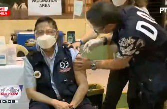 Health Secretary Francisco Duque III gets the first dose of the Sinovac vaccine brand Coronavac on Friday, April 23, 2021 at the Department of Health office. (Screenshot of PTV 4 video/Courtesy PTV-4)