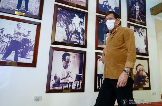 President Rodrigo Roa Duterte walks past old photos of past presidents as he arrives for the meeting with the Inter-Agency Task Force on the Emerging Infectious Diseases (IATF-EID) core members at the Malacañang Golf (Malago) Clubhouse in Malacañang Park, Manila on April 15, 2021. KING RODRIGUEZ/ PRESIDENTIAL PHOTO