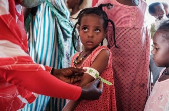 A four-year-old Ethiopian girl who fled the Tigray conflict as a refugee is measured at a malnutrition center at Village Eight transit centre near the Ethiopian border in Gedaref, eastern Sudan, on December 2, 2020. (Photo by Yasuyoshi CHIBA / AFP)