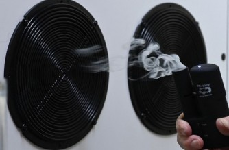 An Aerosol ventilation is demonstrated at an electrical filter system at Steinicke in Berlin on December 3, 2020. - Electrical filter systems are intended to help exchanging the air in rooms to curb the spread of the novel coronavirus COVID-19. (Photo by Tobias Schwarz / AFP)