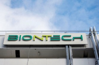 A photo taken on March 27, 2021 shows the logo on the facade of the new manufacturing site of German company BioNTech for the production of the Covid-19 vaccine in Marburg, central Germany. - German firm BioNTech said on March 30, 2021 it was on track to manufacture 2.5 billion doses of its Covid-19 vaccine this year with US partner Pfizer, 25 percent more than previously expected. (Photo by Thomas Lohnes / AFP)