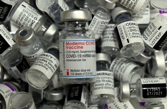 Empty vials of different vaccines by Moderna, Pfizer-BioNTech and AstraZeneca against Covid-19 caused by the novel coronavirus are pictured at the vaccination center in Rosenheim, southern Germany, on April 20, 2021, amid the novel coronavirus / COVID-19 pandemic. (Photo by Christof STACHE / AFP)