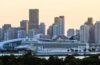 (FILES) In this file photo taken on April 14, 2021 a docked Norwegian Gem cruise ship is seen at the Port of Miami in Miami Beach, Florida. - Cruise ships may be able to resume sailing from ports in Florida in mid-July after being shut down for over a year by the coronavirus pandemic, according to new guidelines from US health authorities. The US Centers for Disease Control (CDC) informed cruise companies on April 28, 2021 of the requirements they would need to meet to begin sailing again. (Photo by CHANDAN KHANNA / AFP)