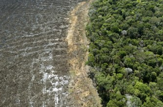 (FILES) In this file photo taken on August 07, 2020, aerial picture of a deforested area close to Sinop, Mato Grosso State, Brazil. - A total of 580.55 square kilometres were deforested in the Brazilian Amazon in April 2021, a record level for the month, according to official data released on May 7, 2021, defying President Jair Bolsonaro's promises to reduce deforestation. (Photo by Florian PLAUCHEUR / AFP)