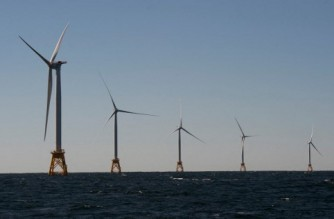 (FILES) In this file photo taken on October 14, 2016 wind turbines, of the Block Island Wind Farm, tower over the water off the shores of Block Island, Rhode Island. - The US announced on May 11, 2021 that it had granted final approval for its biggest wind power project yet, which will be located off the coast of the eastern state of Massachusetts. (Photo by Don EMMERT / AFP)