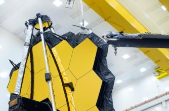 "This handout image released by NASA on May 11, 2021 shows NASA's James Webb Space Telescope undergoing tests at Northrop Grumman in Redondo Beach, California. - The world's largest and most powerful space telescope ever built unfolded its giant golden mirror for the last time on Earth on May 11, a key milestone before the $10 billion observatory is launched later this year. The 21 feet 4 inch (6.5 meter) mirror was commanded to fully expand and lock itself into place, NASA said -- a final test to ensure it will survive its million-mile (1.6 million kilometer) journey and is ready for its quest to discover the origins of the Universe. (Photo by Chris GUNN / NASA / AFP) / RESTRICTED TO EDITORIAL USE - MANDATORY CREDIT ""AFP PHOTO / NASA / CHRIS GUNN "" - NO MARKETING - NO ADVERTISING CAMPAIGNS - DISTRIBUTED AS A SERVICE TO CLIENTS"